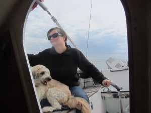 Sherrie sailing with her dog Mango